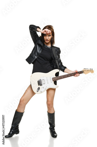 Expressive woman playing the guitar in full length