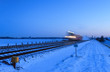 Train speeding in winter.