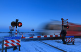 Train and railroad crossing in winter
