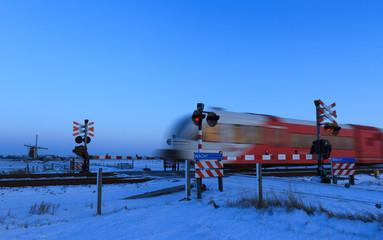 Train @ railroad crossing in winter