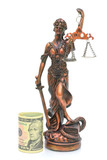 statue of justice and money on a white background