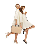 two teenage girls in white coats with bag