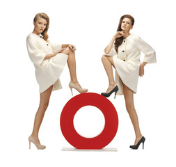 two teenage girls with o letter