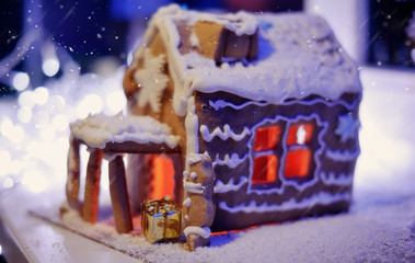 Christmas cake, a small house with snowflakes, and fire in the s