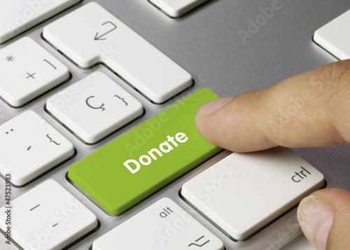 Leinwandbild Motiv Donate keyboard key. Finger