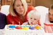 Family Celebrating Children's Birthday With Grandmother