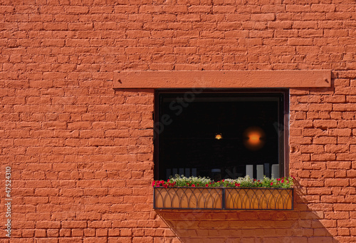 Light in Window in Brick Building