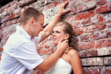 Bride and groom posing near castle