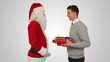 Young Businessman receiving a present from Santa Claus