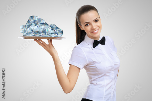 Waitress holding a tray with money