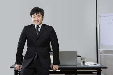 Chinese business man standing in office