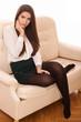 elegant woman sitting on sofa
