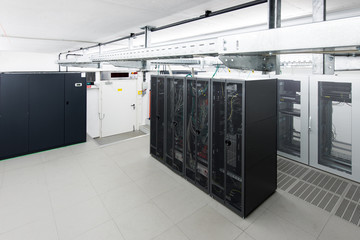small air conditioned server room with climate control unit