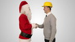 Santa Claus and Young Architect against white, shaking hands