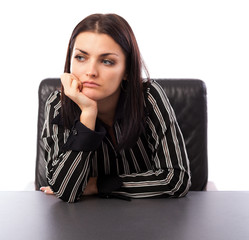 Young businesswoman thinking while sitting at desk