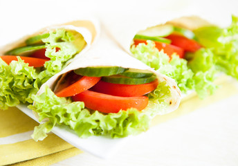 cucumbers, tomatoes and salad in pita