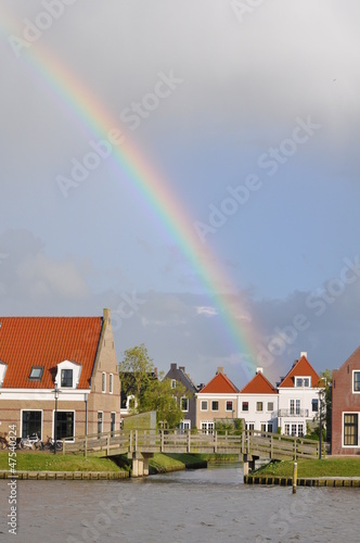 Dutch small village with rainbow