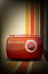 Red vintage radio on retro stripe background with vignetting