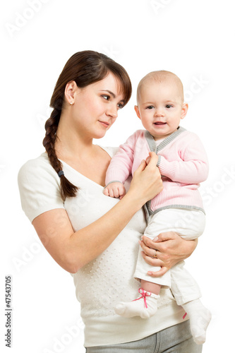 loving mother holding baby girl isolated on white