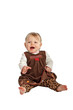 Cute laughing baby in brown velvet dress