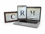 Text CRM on screen of laptop, tablet  pc. 3d