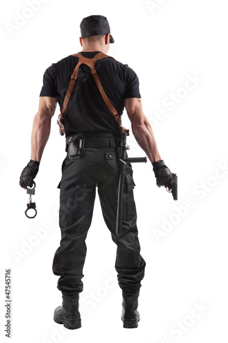 Police officer with handcuffs and gun