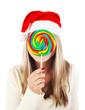 Santa girl eating lollipop