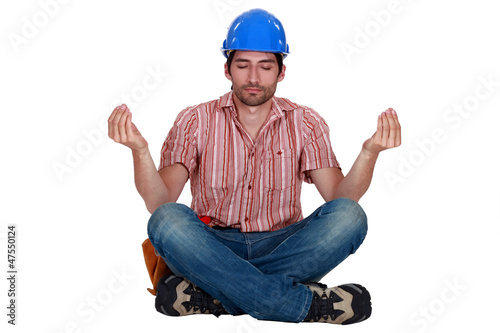 Builder sitting in yoga position