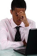 Worried businessman at a laptop