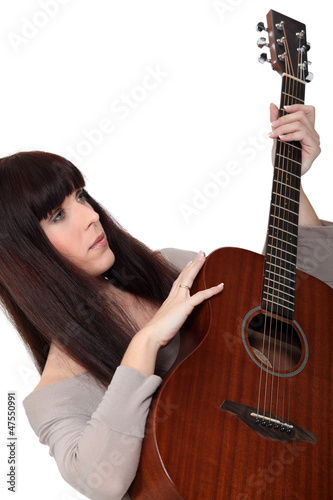 Woman with an acoustic guitar