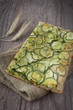 Sliced pizza with zucchini