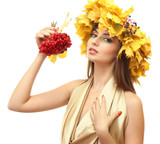 beautiful young woman with yellow autumn wreath and viburnum,