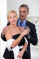 Formal couple drinking champagne
