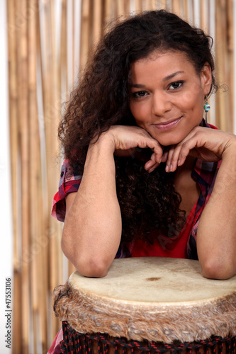 Portrait of a woman with her djembe