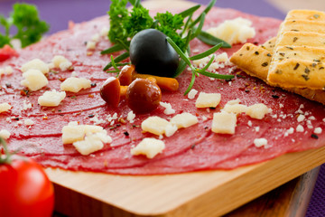 Carpaccio with olives and parmesan