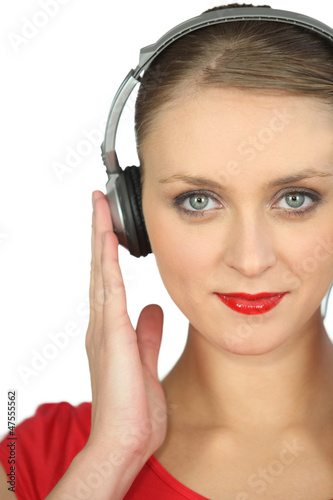 Close-up shot of a woman listening to music