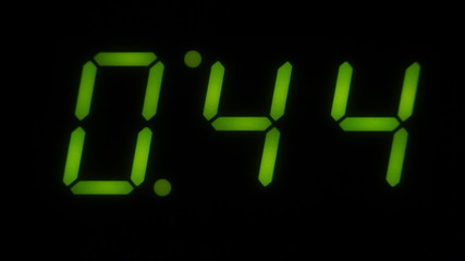 A green LED digital countdown clock. One minute