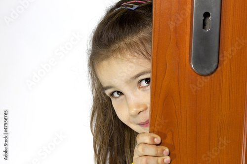 Girl opening  the door and mysterious smiling