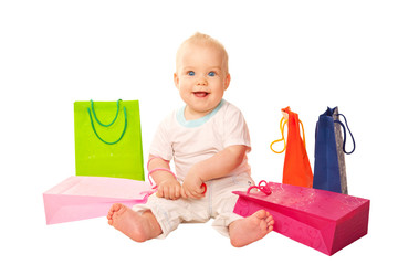 Baby shopping. Happy kid with shopping bags.
