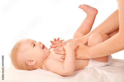 Leinwanddruck Bild Baby massage. Mother massaging kid belly, baby laughing.