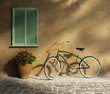 Tuscan stucco wall, doorway antique romantic vintage bicycle
