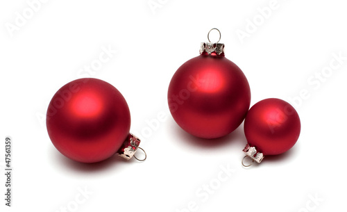 Red christmas balls on white background.