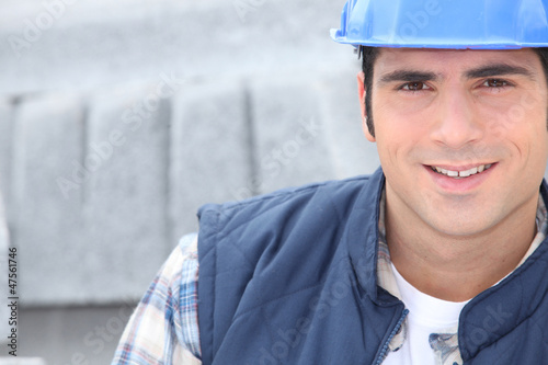 construction worker with concrete curb