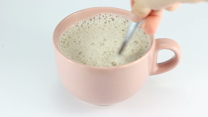 Mixing coffe milk with spoon