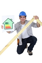 Tradesman holding a frame and an energy efficiency rating chart
