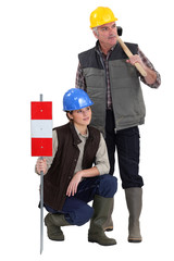 young female apprentice and senior carpenter