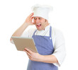 Mad chef cook with tablet pc. Isolated on white