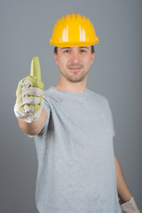 Young male construction worker, with finger up