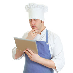 Handsome chef cook using tablet pc. Isolated on white