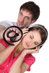 Woman listening to music and a man with an at symbol